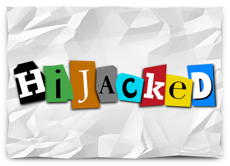 hijacked: Hijacked word in cut out letters on a ransom note for a group, vehicle, meeting or organization that has been overthrown, taken over or controlled by force Stock Photo
