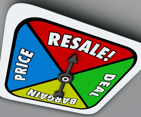 Resale word on a board game spinner to reach a deal, buy, sell or bargain on old or preowned goods or merchandise Archivio Fotografico