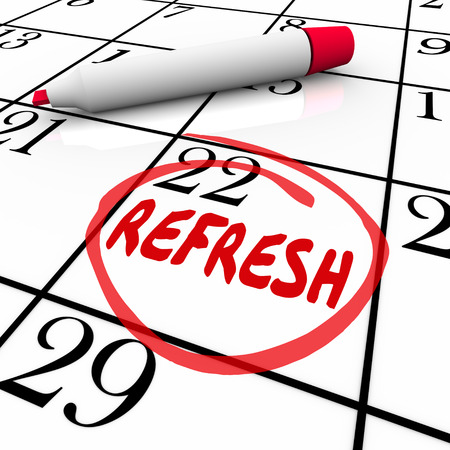 relaunch: Refresh word circled on a calendar day or date to illustrate a reminder to relaunch, restart or revise a product or service Stock Photo