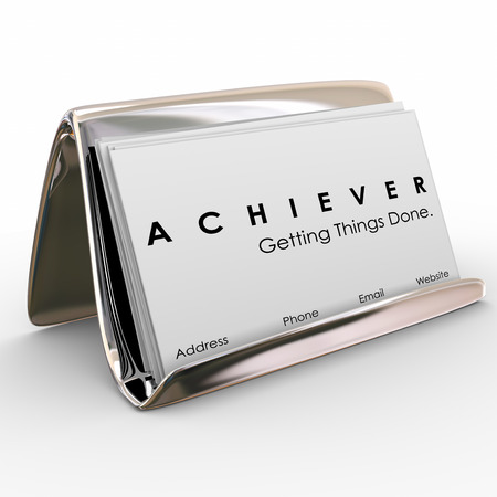 your: Achiever word on business cards in a holder to promote your expertise and ability to get things done in job, career or life