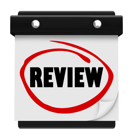 Review word circled on a wall calendar day or date to illustrate a reminder for your evaluation, assessment, testing or rating