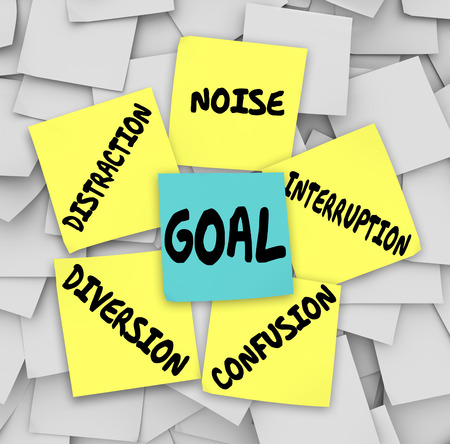interrupted: Goal word on sticky note surrounded by distractions, diversions, confusion, interruptions, and noise to keep you from accomplishing your mission or objective Stock Photo