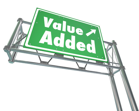 Value Added word on green freeway road sign to illustrate an additional bonus, special supplement or benefit with your purchase
