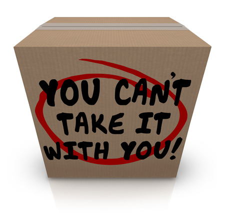 possessive: You Cant Take It With You words written on a cardboard box telling you to share your possessions with others in need since they will be useless when you die in afterlife