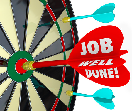 finished good: Job Well Done words on a 3d arrow hitting a bulls eye on a dart board  Stock Photo