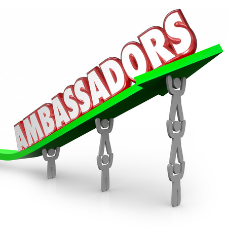 operative: Ambassadors word in 3d red letters on an arrow lifted by people serving as diplomats or representatives from a company, organization or country Stock Photo