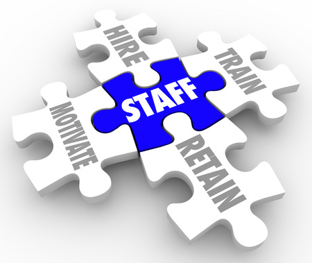 onto: Staff Word on a puzzle piece and others connected to it with terms hire, train, motivate and retain to illustrate human resources challenges