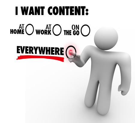 I Want Content Everywhere - person or man choosing to have articles, information, photos or videos available via a delivery network at home, work, and mobile on the go photo