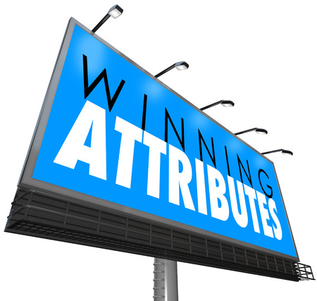 traits: Winning Attributes words on a billboard, sign or banner to illustrate or advertise traits or qualities making you successful in life, career, job or work Stock Photo