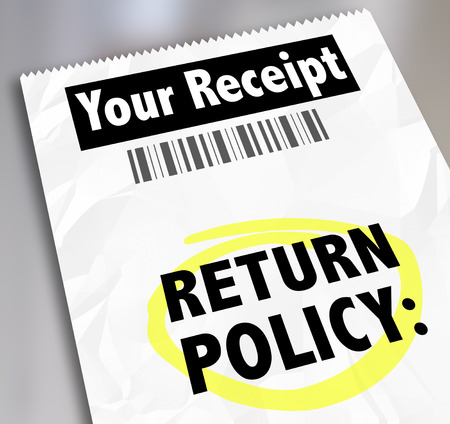 Return Policy words on a store receipt or proof of purchase to tell you how to exchange goods, products or services you no longer want Foto de archivo