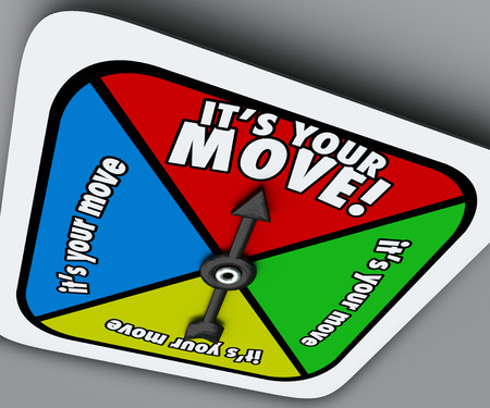 It's Your Move words on a game board spinner telling you to take a turn and advance forward in a competition, job, career or life Foto de archivo