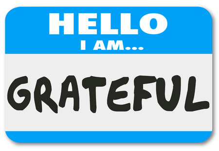 gratified: Hello I Am Grateful words on a name tag sticker telling others you are thankful and appreciative for the valuable things in your life such as health, friends and family