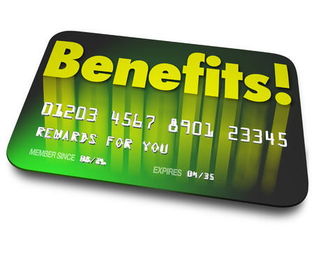Benefits word on a green credit card to illustrate shopper loyalty points earned by using the card in a rewards program to encourage more purchases or buying 写真素材