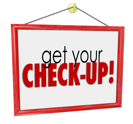 tip up: Get Your Check-Up words on a doctor office or mechanic garage sign to remind you to get a physical, examination, evaluation or other preventative care