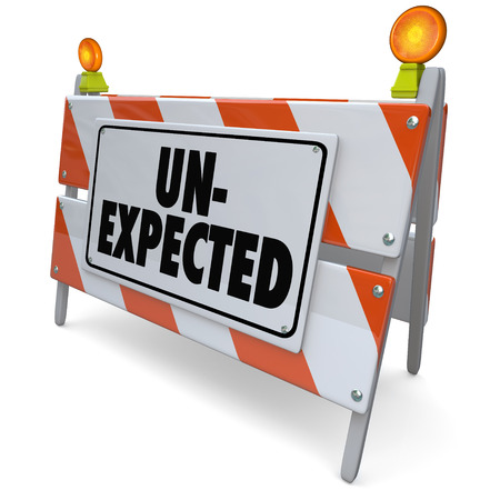 expectations: Unexpected word on a road construction barrier or blockade to illustrate a development that is shocking or surprising and catches you off-guard Stock Photo