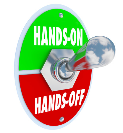 intruding: Hands On Vs Off words on a toggle switch to illustrate getting involved and take action on a project or opportunity