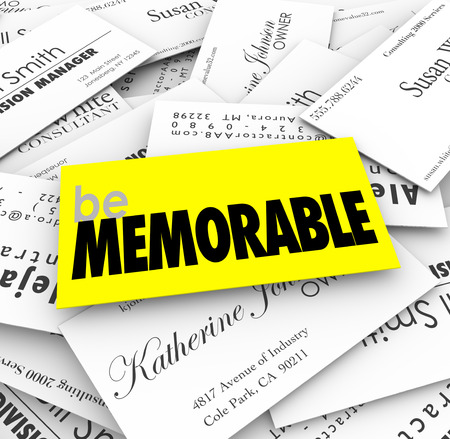 memorable: Be Memorable words on a unique, special or different business card in a pile to illustrate the need to stand out and compete with others for new sales Stock Photo