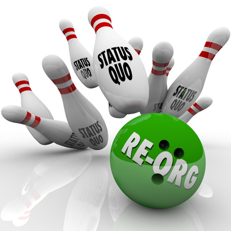 Re-Org word on a green bowling ball striking pins marked Status Quo to illustrate shaking up an organization and changing roles for employees or workers Stock Photo
