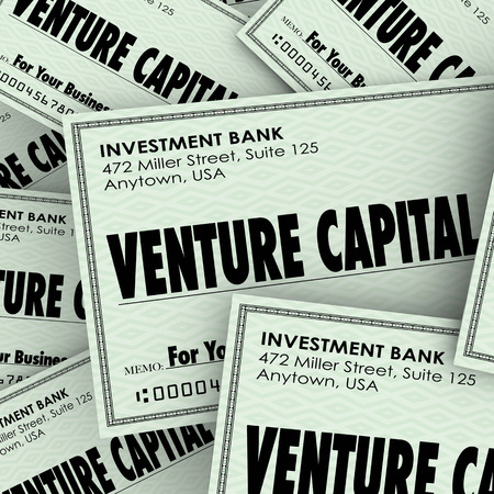 backing up: Venture Capital words on checks to illustrate money or financial investment in a new business or company to grow and achieve success Stock Photo