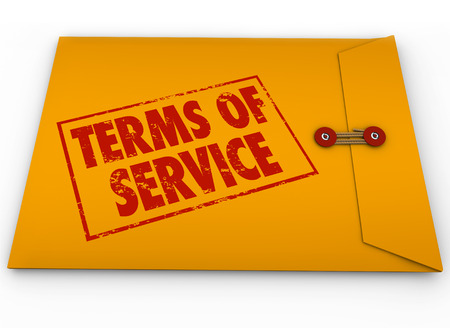 obligations: Terms of Service words on stamp on yellow envelope to illustrate a contract, obligations, agreement and restrictions in signing up for service or using software