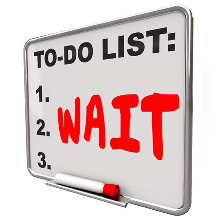 delay: Wait word on a to do list to illustrate a delay or frustration over wasting time anticipating service that is bad, poor or late Stock Photo