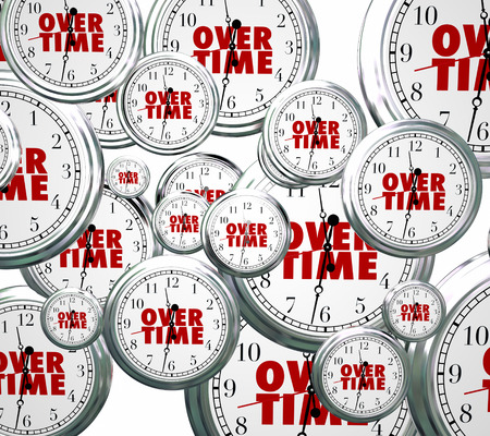 Overtime word on clocks flying by to illustrate time passing as you perform extra or additional work late at your job