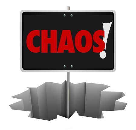 turmoil: Chaos word on a sign in a hole to illustrate a problem, trouble, turmoil, danger or chaotic mess that you should either avoid or solve