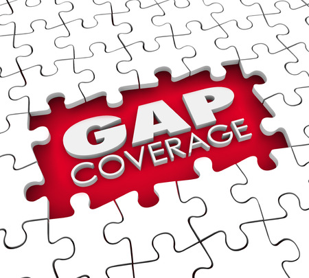 Gap Coverage 3d words in a hole or blank space were puzzle pieces are missing to illustrate supplemental protection needed for your insurance policy Imagens