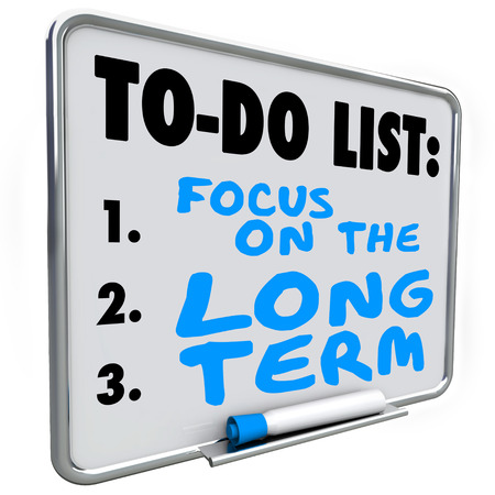 Focus on the Long Term words written on a dry erase board to illustrate investing and working toward lasting results or outcome