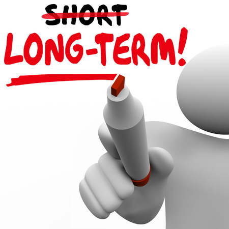 outcome: Long Term Vs Short words written on board with marker to illustrate a plan or strategy of waiting or delaying outcome, payoff or results of project or effort