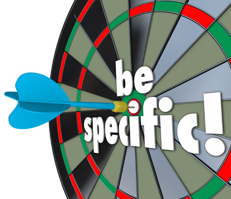 Be Specific 3d words on a dart board to target precise directions and defined goals or objectives for a job, project or task Stock Photo