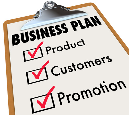 Business Plan words on a checklist on a clipboard with check mark and boxes for product, customers and promotion strategy for planning and preparation for laucnh photo