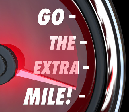 mile: Go the Extra Mile words on a speedometer with needle racing to illustrate extended effort in driving, working or achieving goals or success