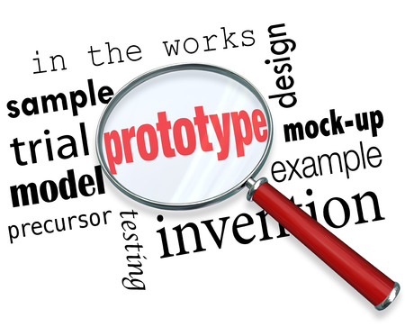 for example: Prototype word under a magnifying glass searching for mock-up, example, sample, trial, model, invention or original design of a new product concept Stock Photo