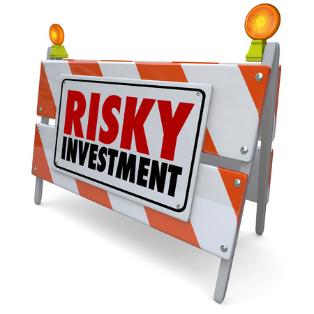 financial adviser: Risky Investment words on a barrier or road construction warning sign to illustrate the need for caution in a dangerous investing strategy for money growth Stock Photo