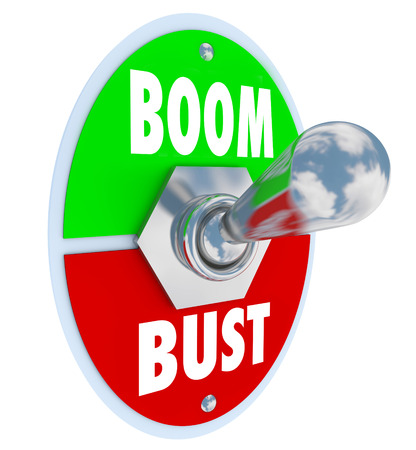 flipped: Boom vs Bust words on a 3d toggle switch or lever to illustrate turning on or off your profits, earnings or economy