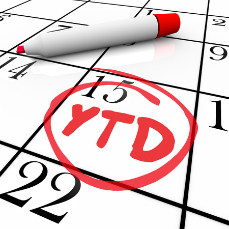 abbreviated: YTD Year to Date letters on a calendar day circled for a status update or total of current progress, earnings or production output or results