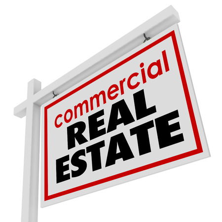 wood sign: Commercial Real Estate sign to advertise or illustrate the sale of an office building or retail store for a business to move to a new location Stock Photo