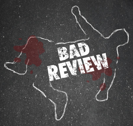 review: Bad Review words on a chalk outline for a dead body of a person killed by negative feedback, comments or criticism for poor performance