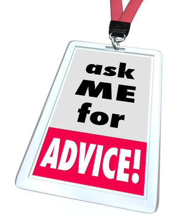 nametag: Ask Me for Advice words on a badge or name tag worn by a worker or employee at a store or business offering help, assistance, support or service Stock Photo