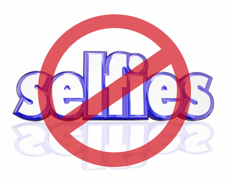 no cameras allowed: No Selfies symbol on 3d letters to illustrate people being annoyed with self portraits taken on digital camera phones and posted on social media