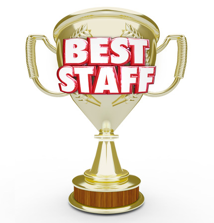 synergies: Best Staff words in 3d letters on a gold trophy given as an award to the top or highest performing team, workforce or employee group