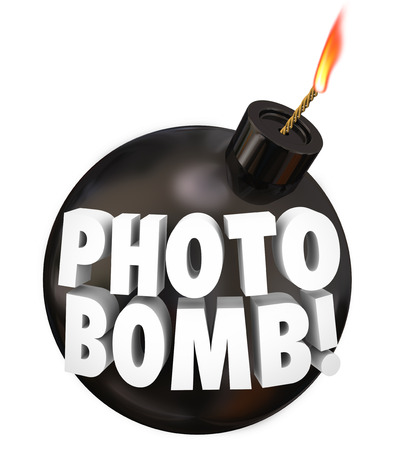 intrude: Photobomb words on a black round bomb to illustrate intruding uninvited in other peoples photographs or picture taking as a prank or practical joke