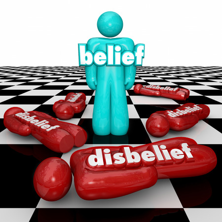 theology: Belief word on a confident person standing as winner or victor on a chess board while others with disbelief or doubt fall or lose the competition, game or life Stock Photo