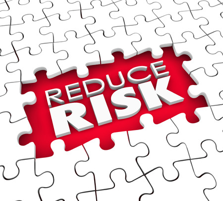 risky behavior: Reduce Risk words in the hold of a puzzle with missing pieces to illustrate the need to lower dangers and increase safety and security Stock Photo