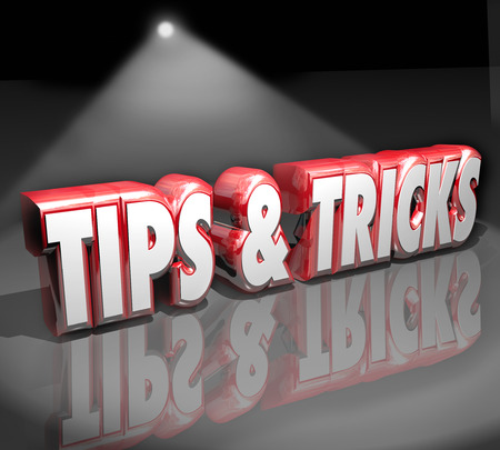 gimmick: Tips and Tricks words in 3d letters under a spotlight to illustrate finding helpful how-to advice or information to do a job or task