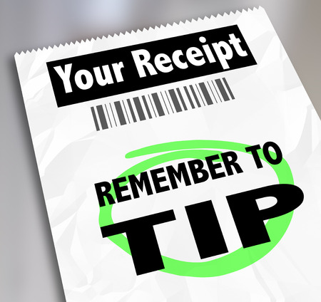 gratuity: Remember to Tip words on a paper receipt or bill from a restaurant, hotel or store reminding you to add gratuity to your payment for great service rendered
