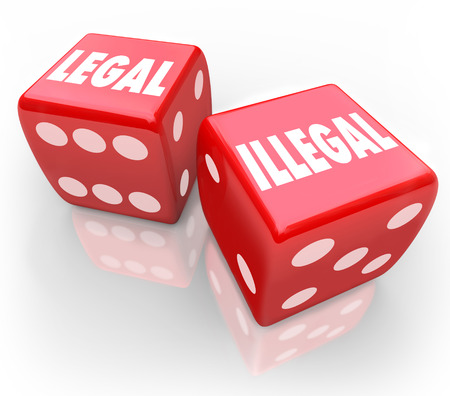 fair trial: Legal and Illegal words on two red dice to illustrate taking your chances on law and regulation issues