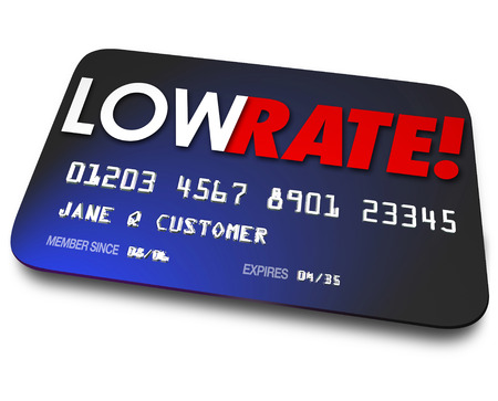 hidden fees: Low Rate words on a credit card to illustrate percentage interest charged on your payments or money owed to finance company Stock Photo