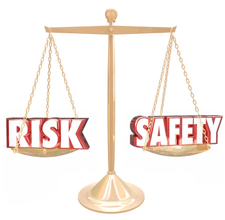 safer: Risk Vs Safety 3d words on a gold scale to illustrate, weigh or compare the differences between two options and their relative danger or warning factors